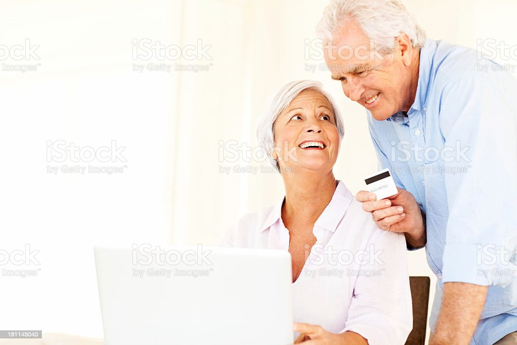 Senior Couple With Laptop And Credit Card Doing Online Shopping royalty-free stock photo