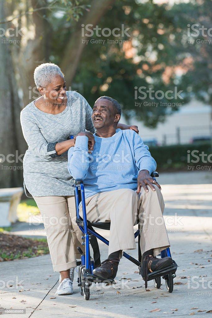 Senior couple with man in wheelchair stock photo