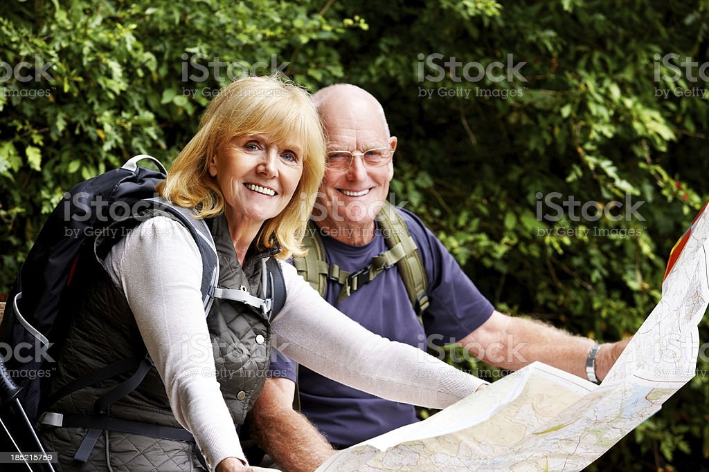 Senior couple with map on a hiking day royalty-free stock photo