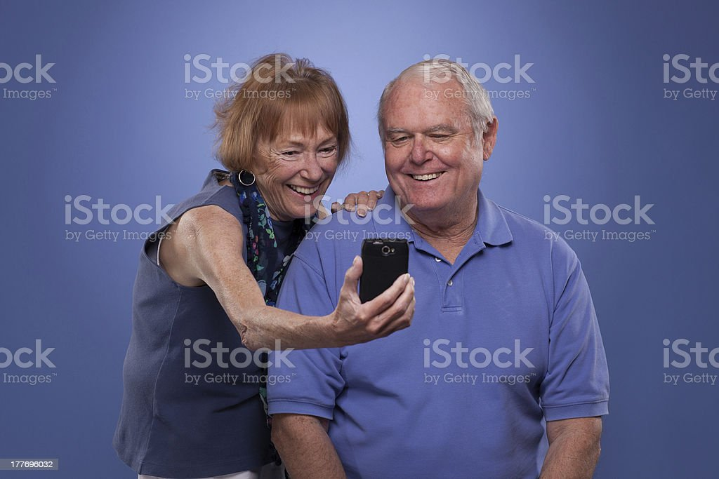 Senior couple with mobile phone royalty-free stock photo