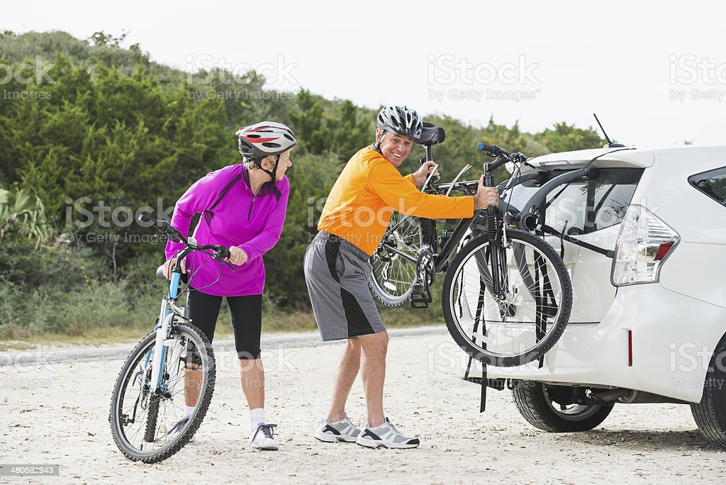 Senior couple with mountain bikes stock photo