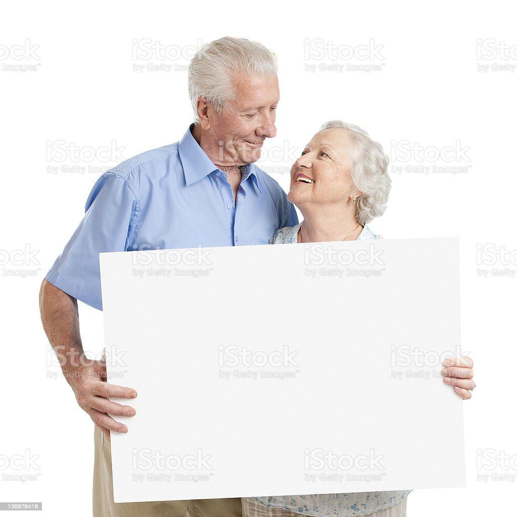 Senior couple with placard stock photo