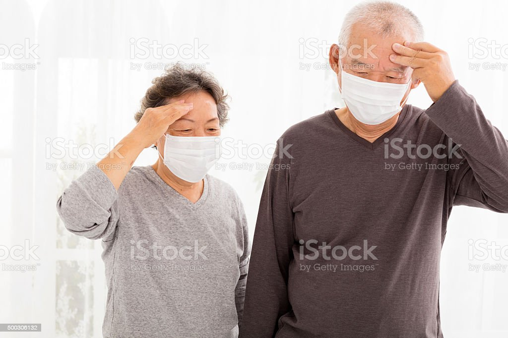 senior couple with protective face mask stock photo