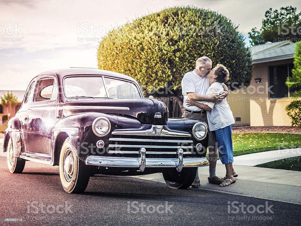 Senior couple with retro car stock photo