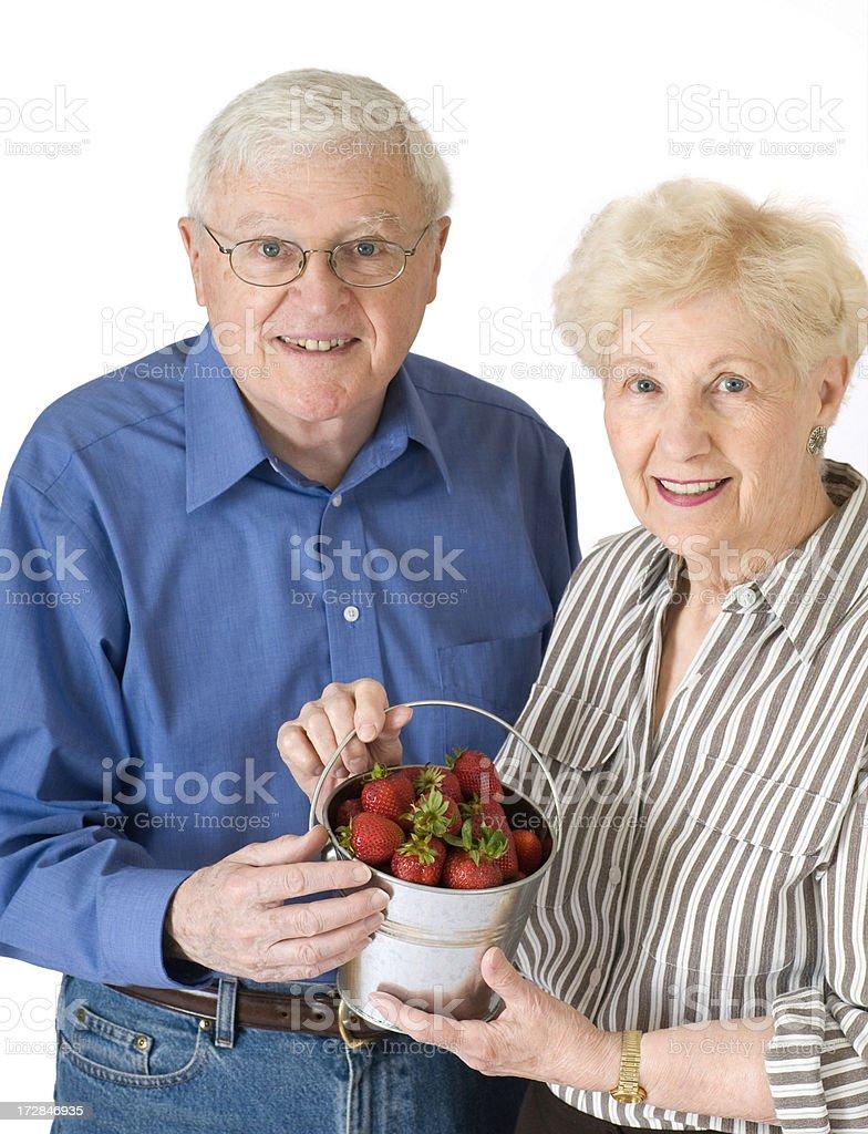 Senior Couple With Strawberries stock photo