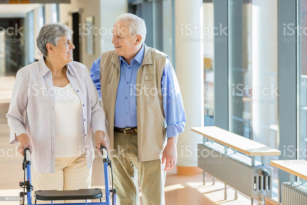 Senior couple with walking frame stock photo