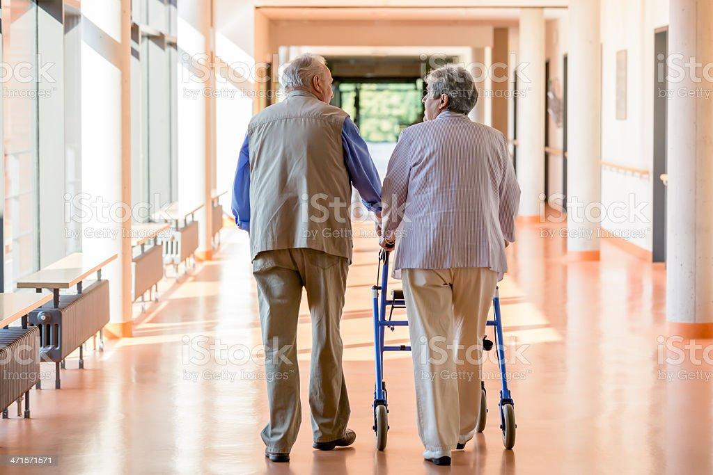 Senior couple with walking frame royalty-free stock photo