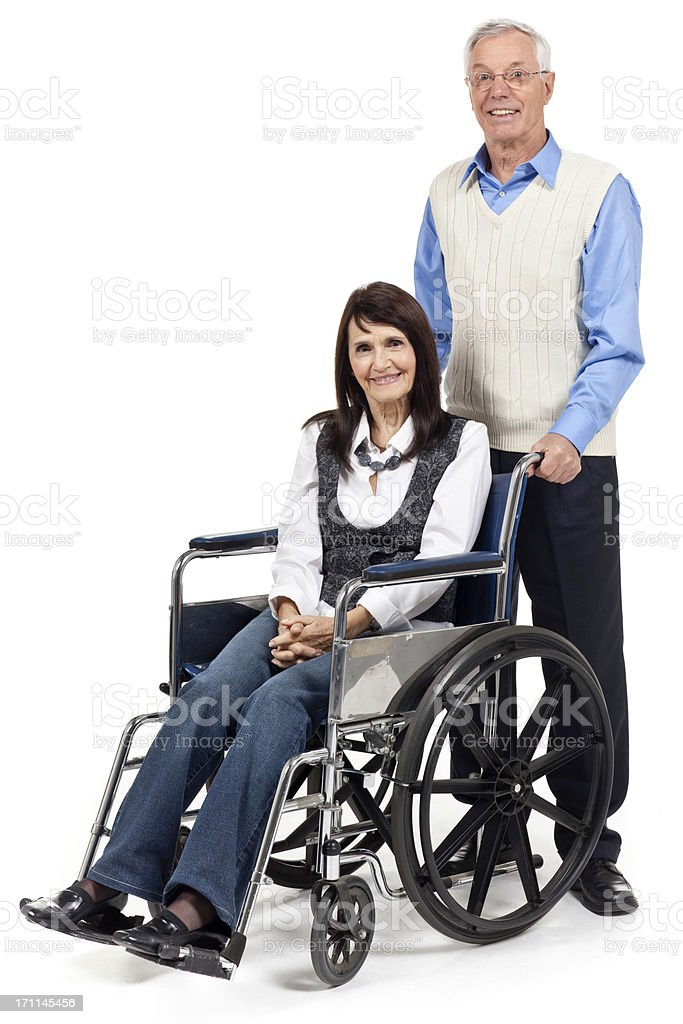 Senior Couple with Wheelchair, Isolated on White Background royalty-free stock photo