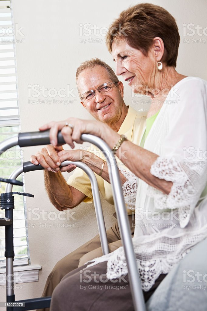 Senior couple, woman with walker stock photo