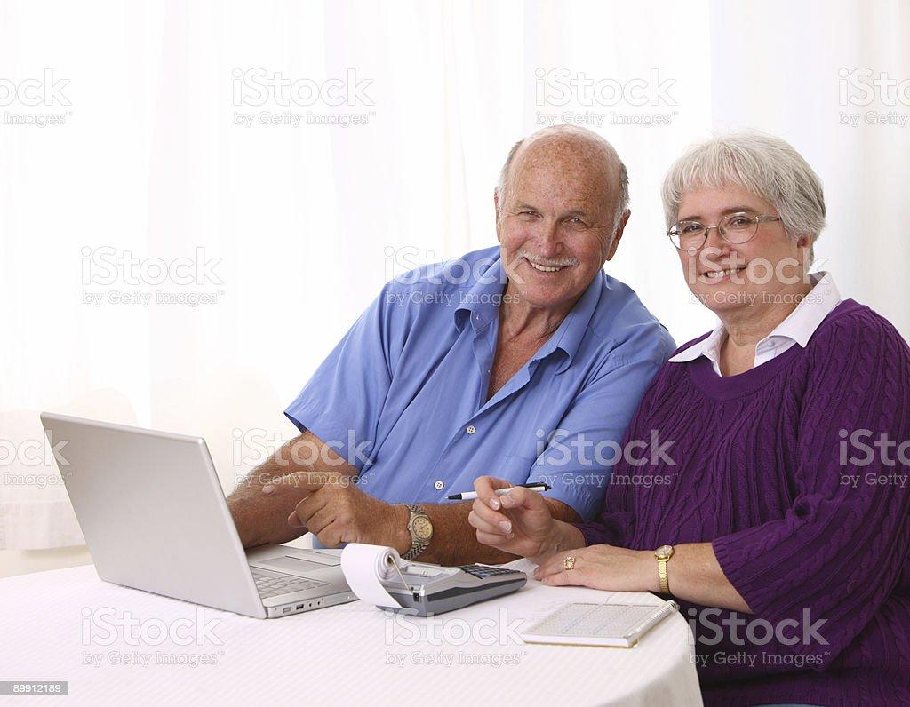 Senior couple working on personal finances royalty-free stock photo