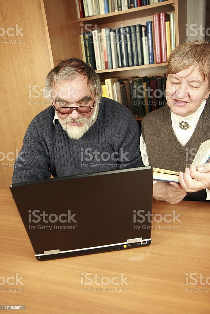 Senior couple working together on a laptop royalty-free stock photo