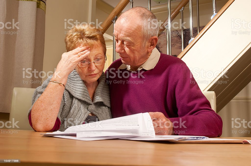 senior couple worry about bills royalty-free stock photo