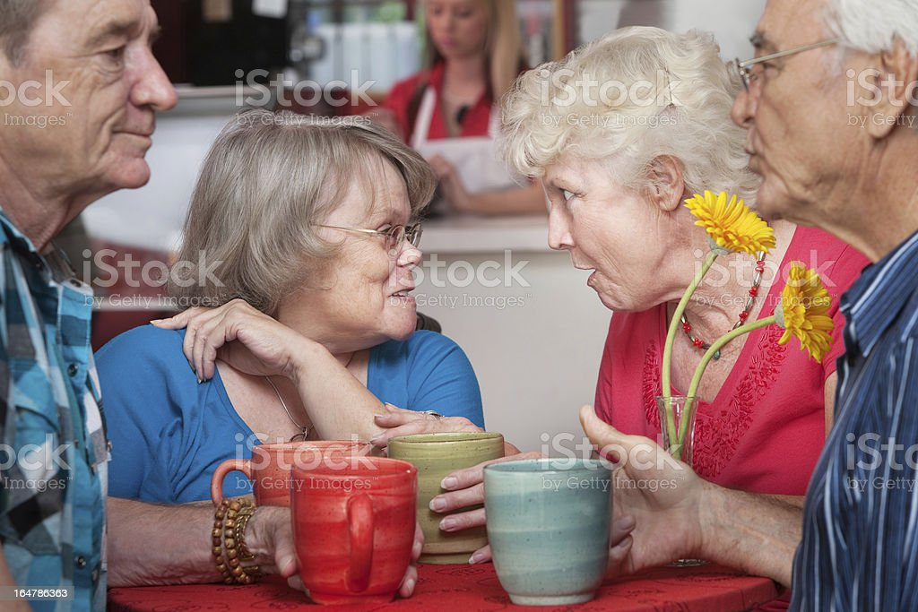 Senior Couples Chatting in Cafe royalty-free stock photo