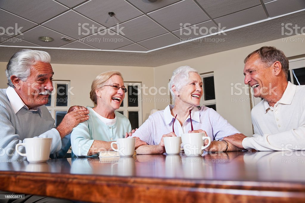 Senior couples drinking coffee stock photo