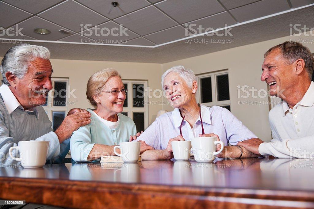 Senior couples drinking coffee royalty-free stock photo