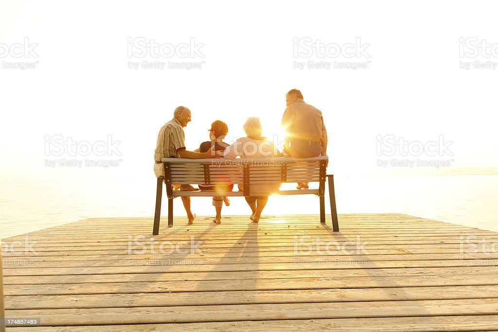 senior couples enjoying sunset stock photo
