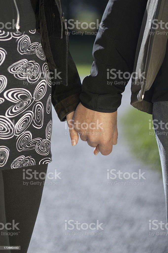 Senior couple's hands stock photo