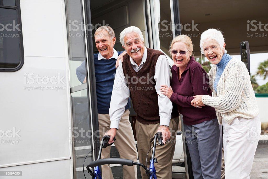 Senior couples outside shuttle bus stock photo