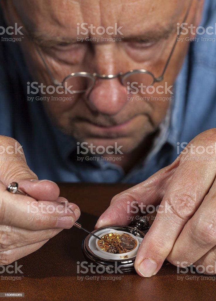 Senior craftsman repairing pocket watch stock photo