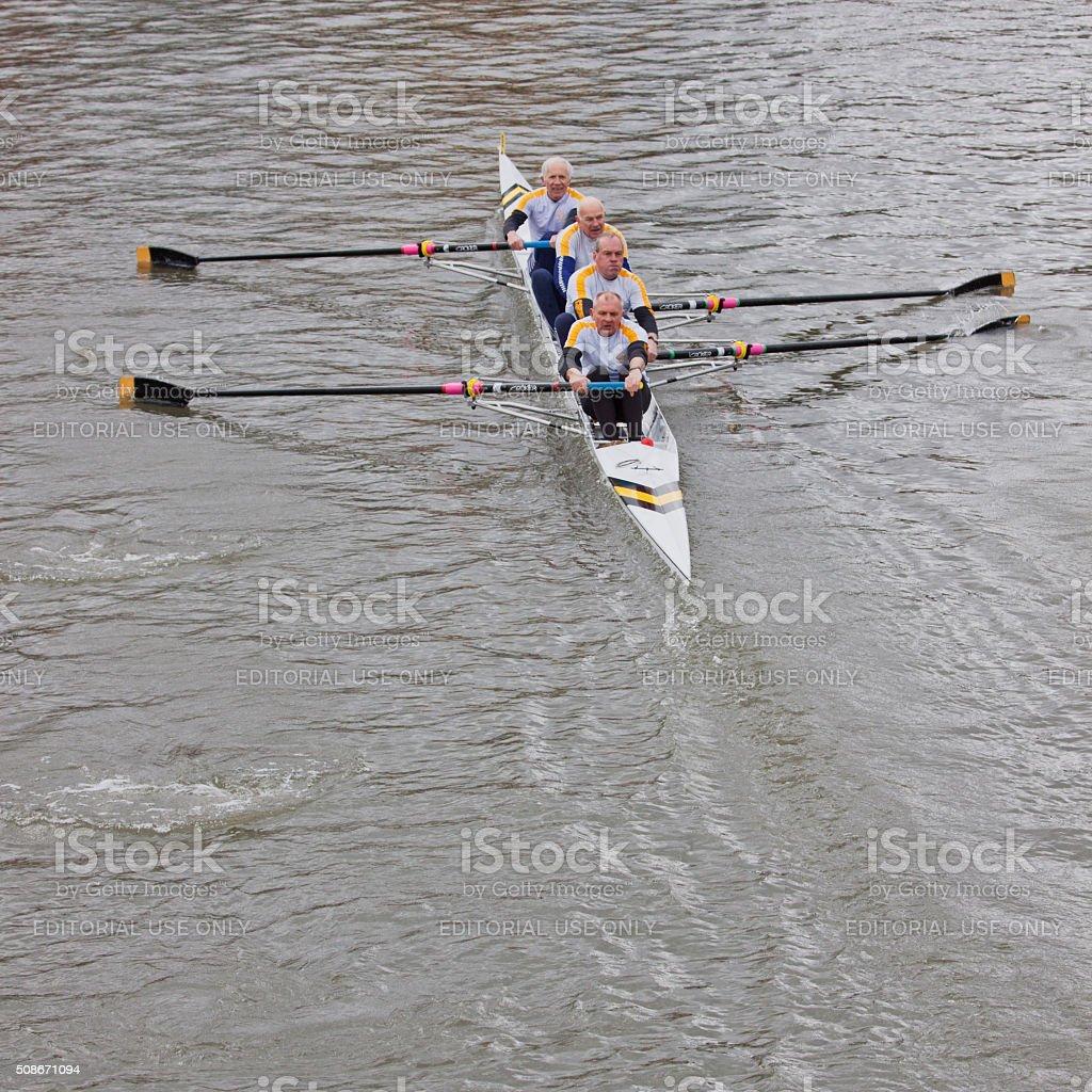 Senior crew competing in a river race UK stock photo