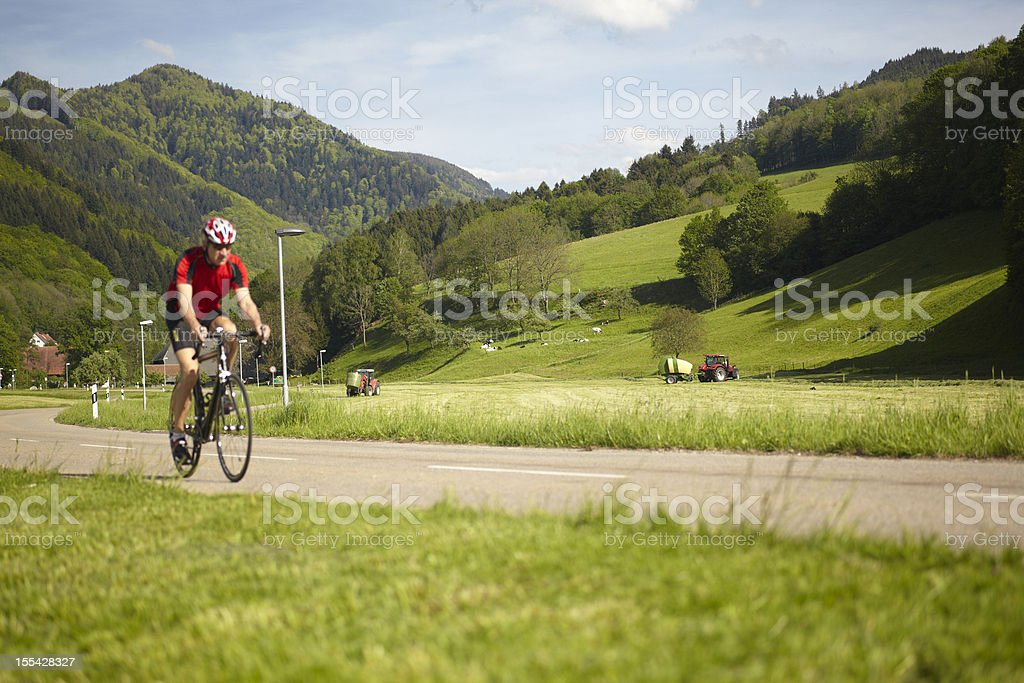 Senior cyclist on a mountain road royalty-free stock photo