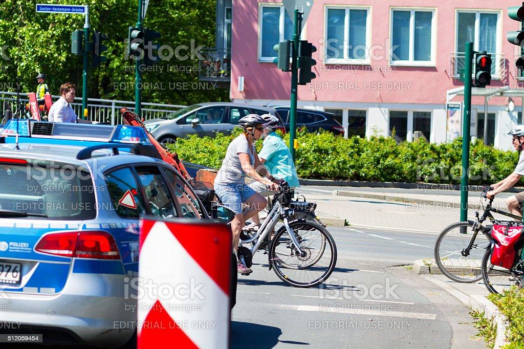 Senior cyclists passing crosswalk stock photo