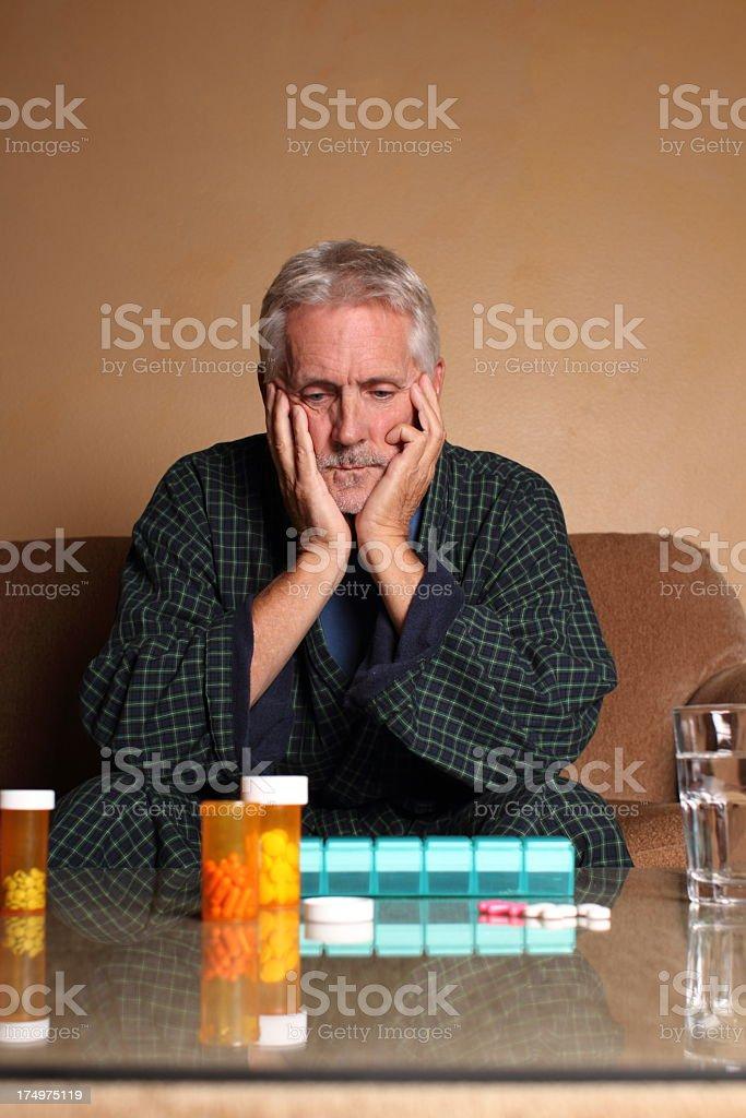 Senior Depressed Man Pill Decisions royalty-free stock photo