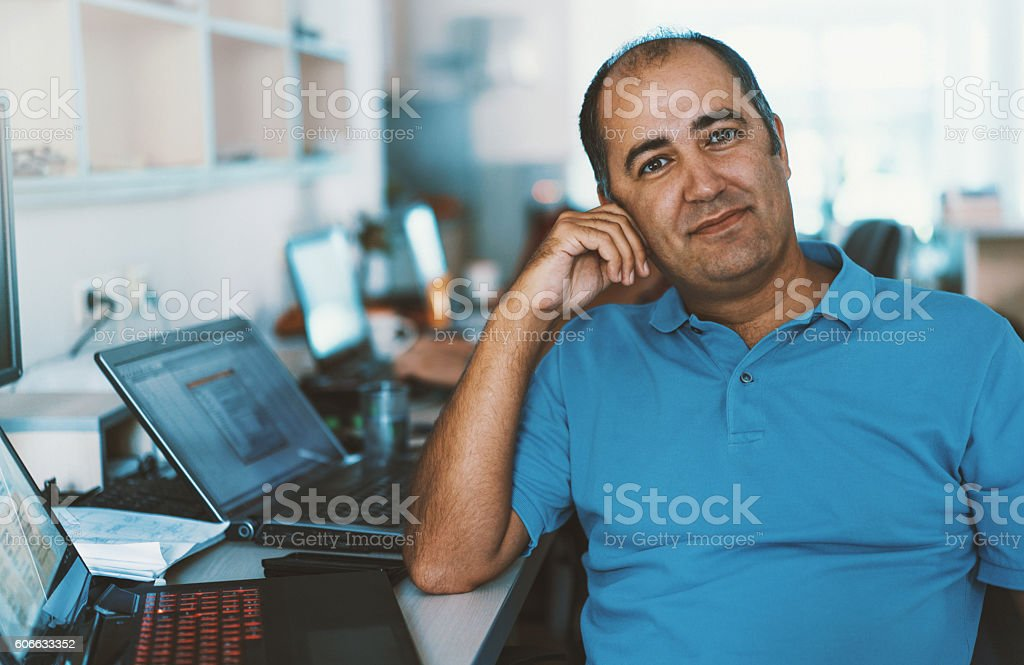 Senior developer at work. stock photo