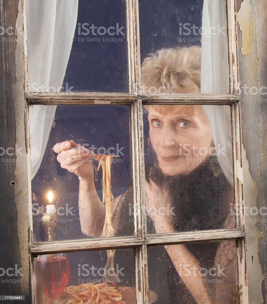 Senior Diner Looking Out Of Window stock photo