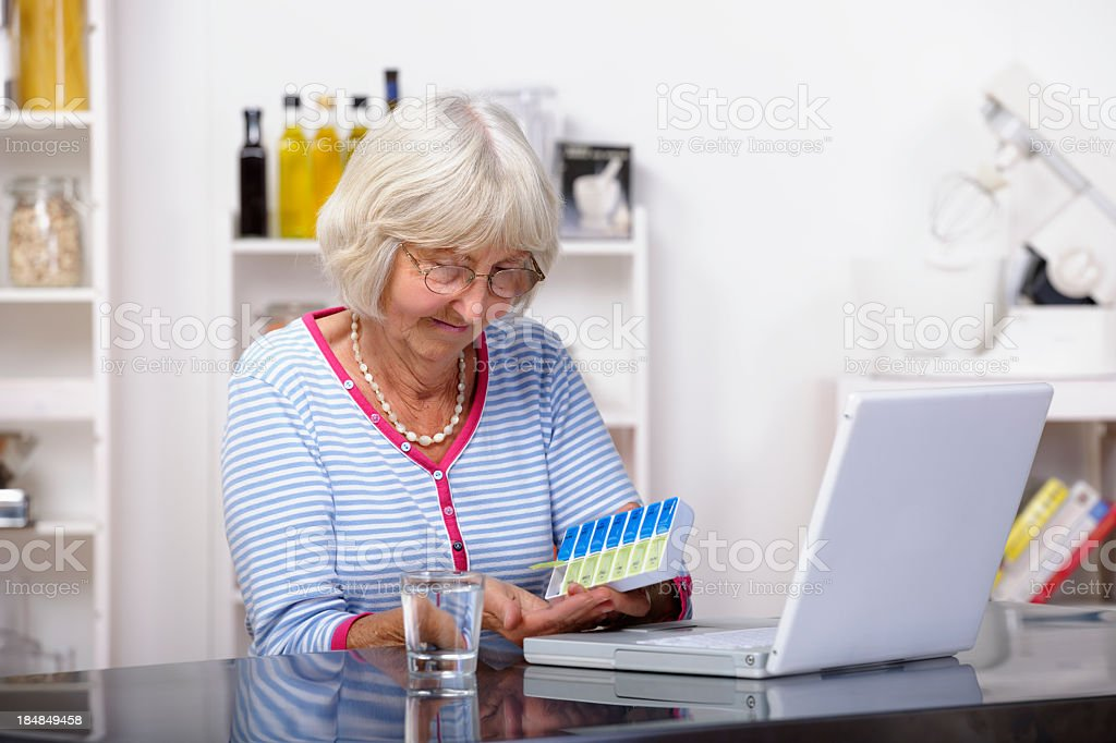 Senior Dispensing Medication From Dorset Box royalty-free stock photo