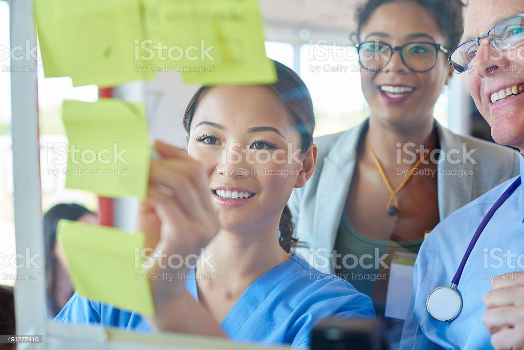 senior doctor and businesswoman brainstorming stock photo