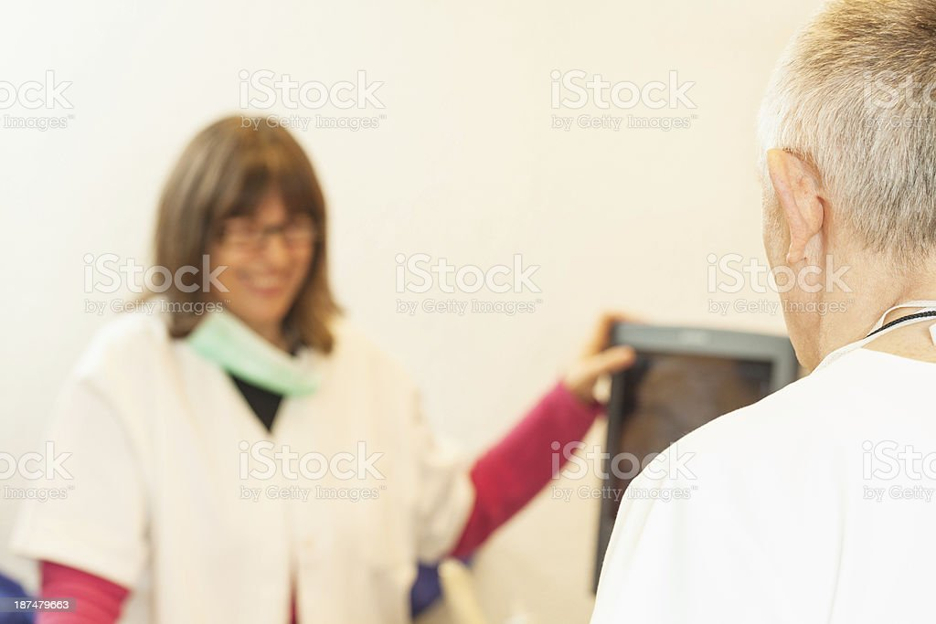 Senior doctor and nurse in office royalty-free stock photo