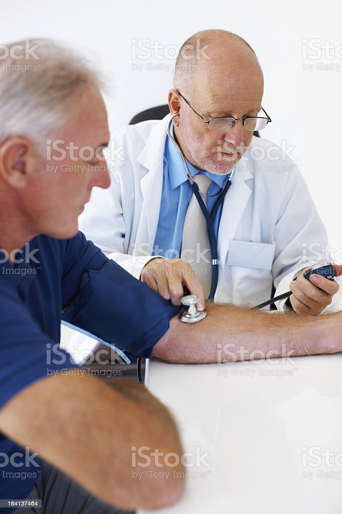 Senior doctor checking blood pressure royalty-free stock photo