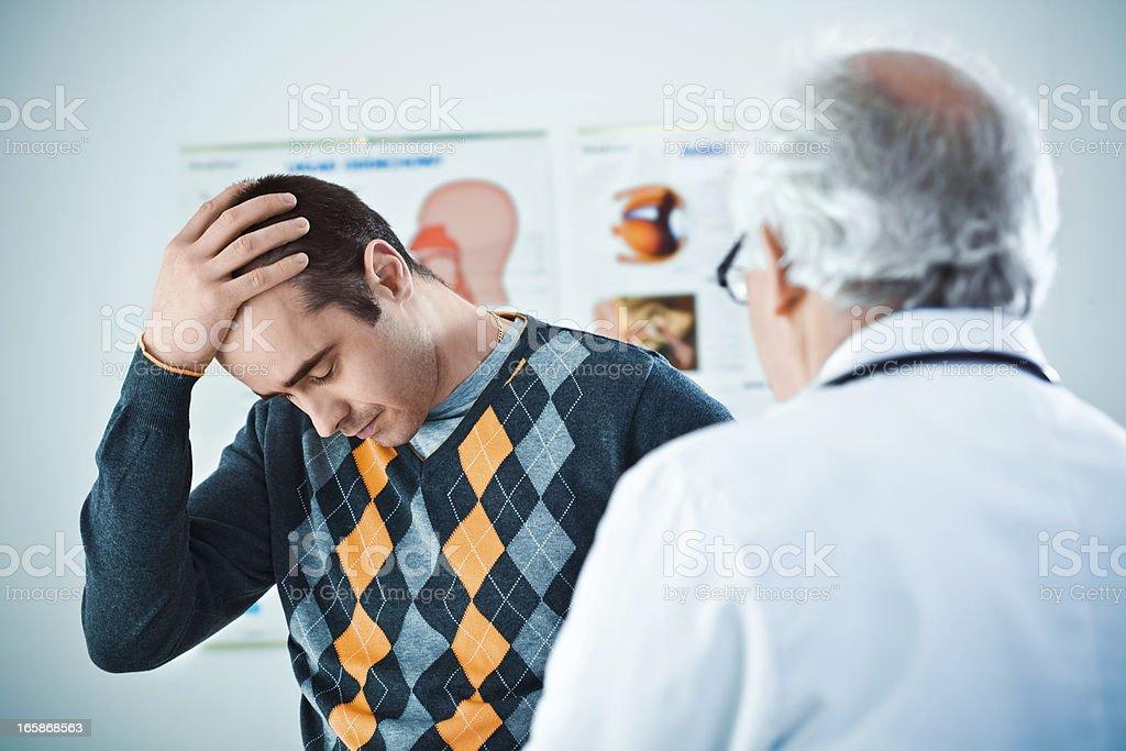 Senior doctor giving bad news royalty-free stock photo