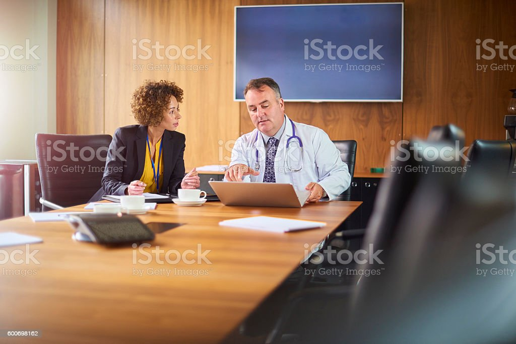 senior doctor in a business meeting stock photo