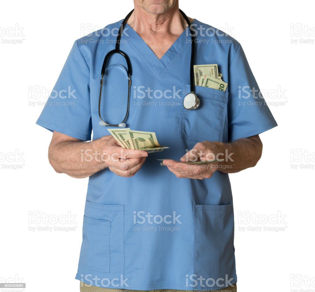 Senior doctor in scrubs counting cash stock photo