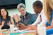 Senior doctor talks in hospital board meeting