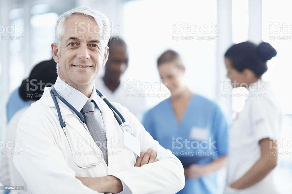 Senior doctor with his medical team royalty-free stock photo