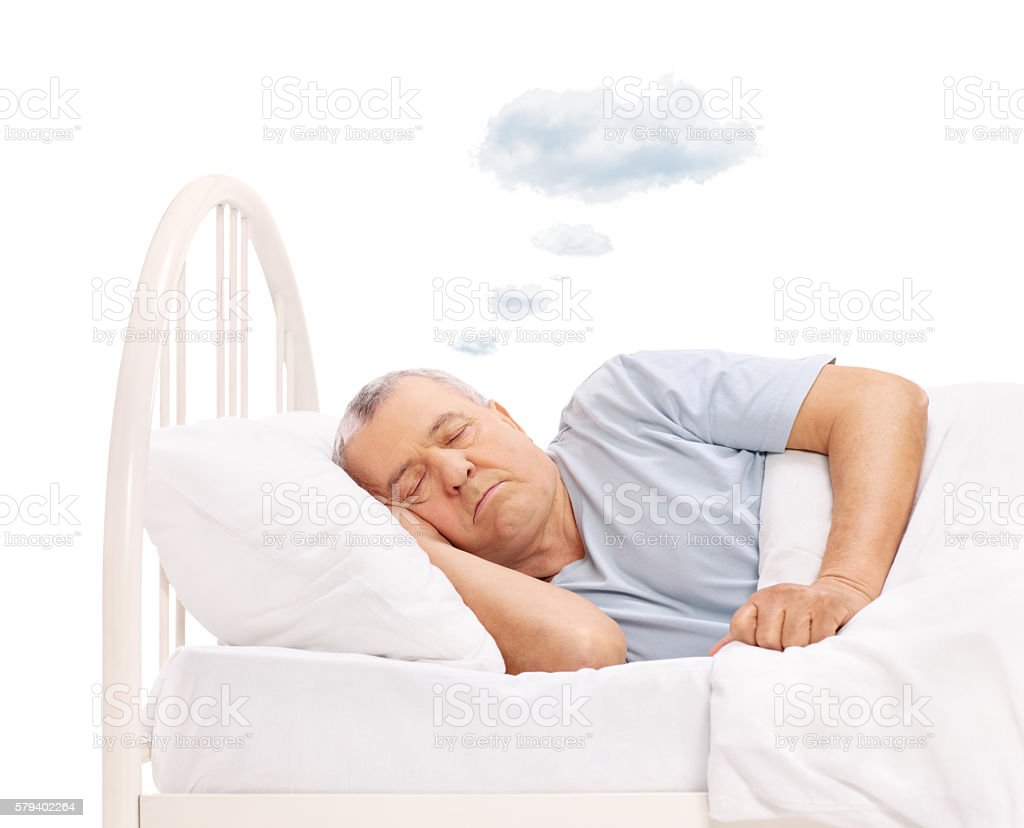 Senior dreaming with cloud above head stock photo