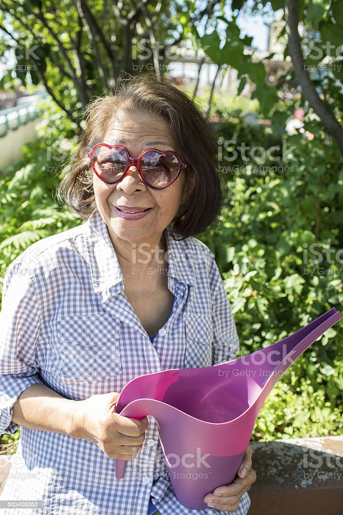 Senior elderly asian woman gardening royalty-free stock photo