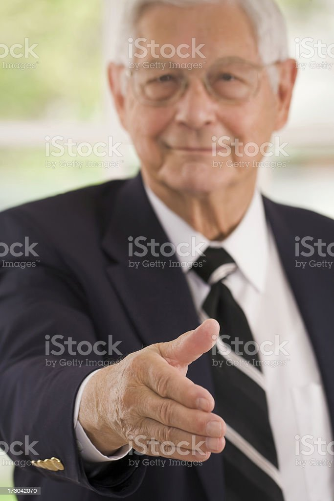 senior executive man with hand extended to shake hands royalty-free stock photo