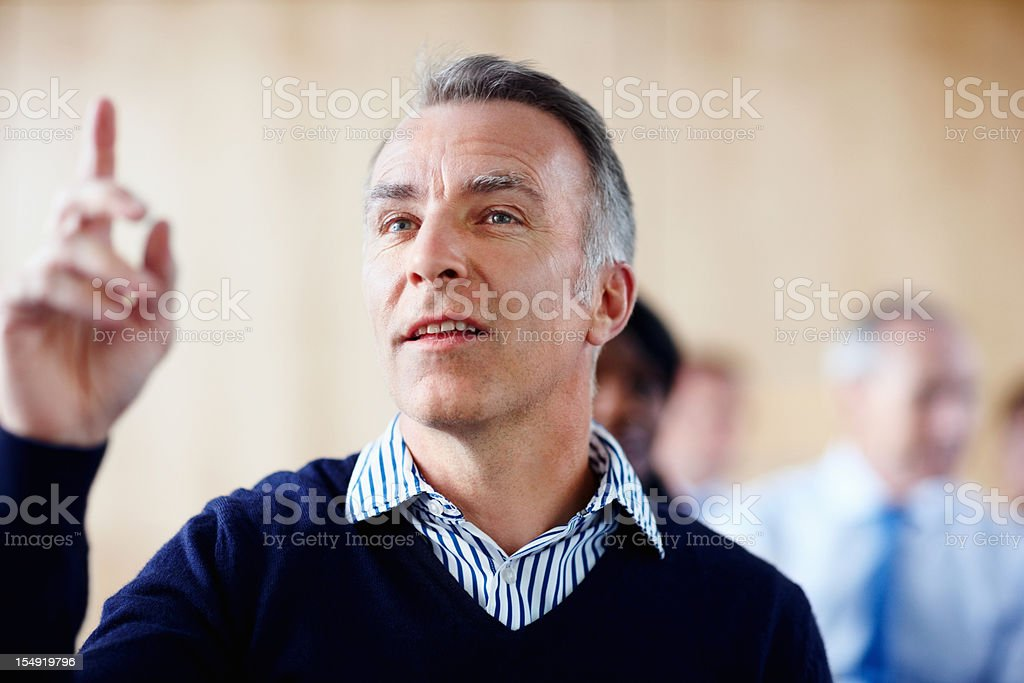 Senior executive raising his hand royalty-free stock photo