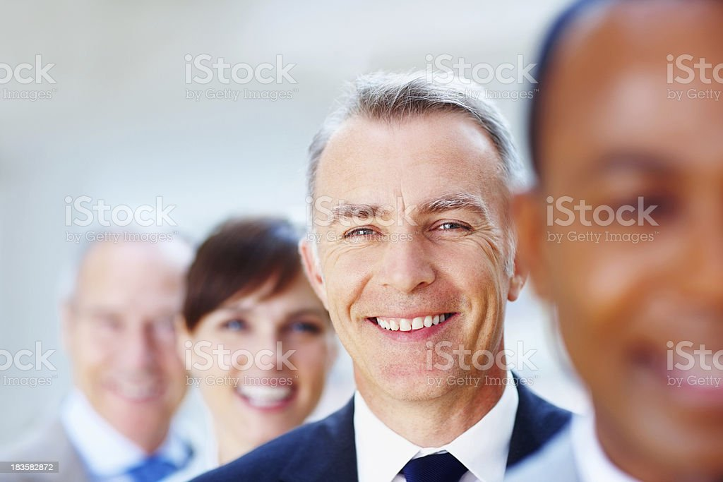 Senior executive with colleagues royalty-free stock photo