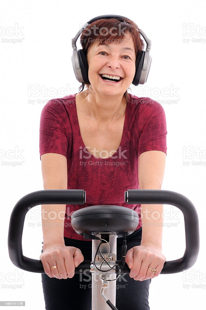 Senior spinning woman listening music royalty-free stock photo
