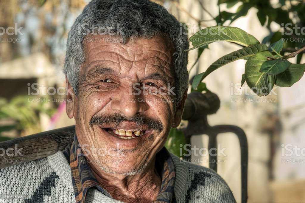 Senior Farmer holding a fork and smiling stock photo