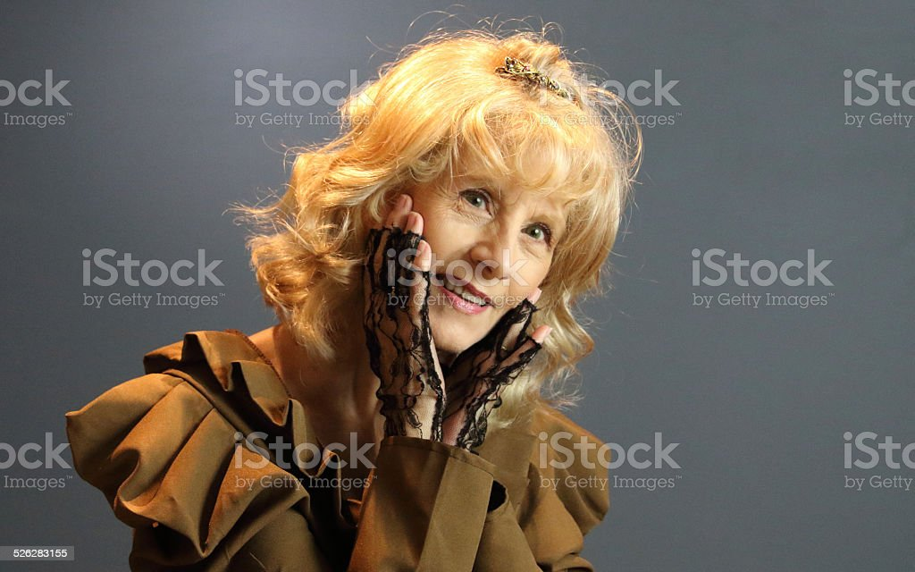 Senior Female Adult Gesturig With Her Hands stock photo