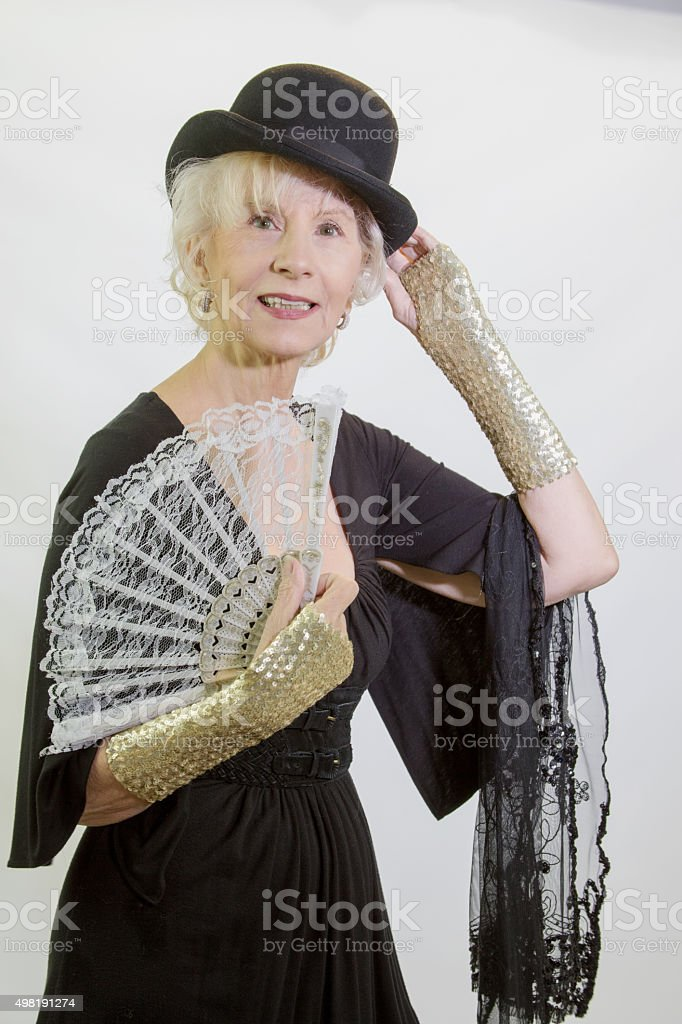 Senior Female Adult With Derby And Fan stock photo