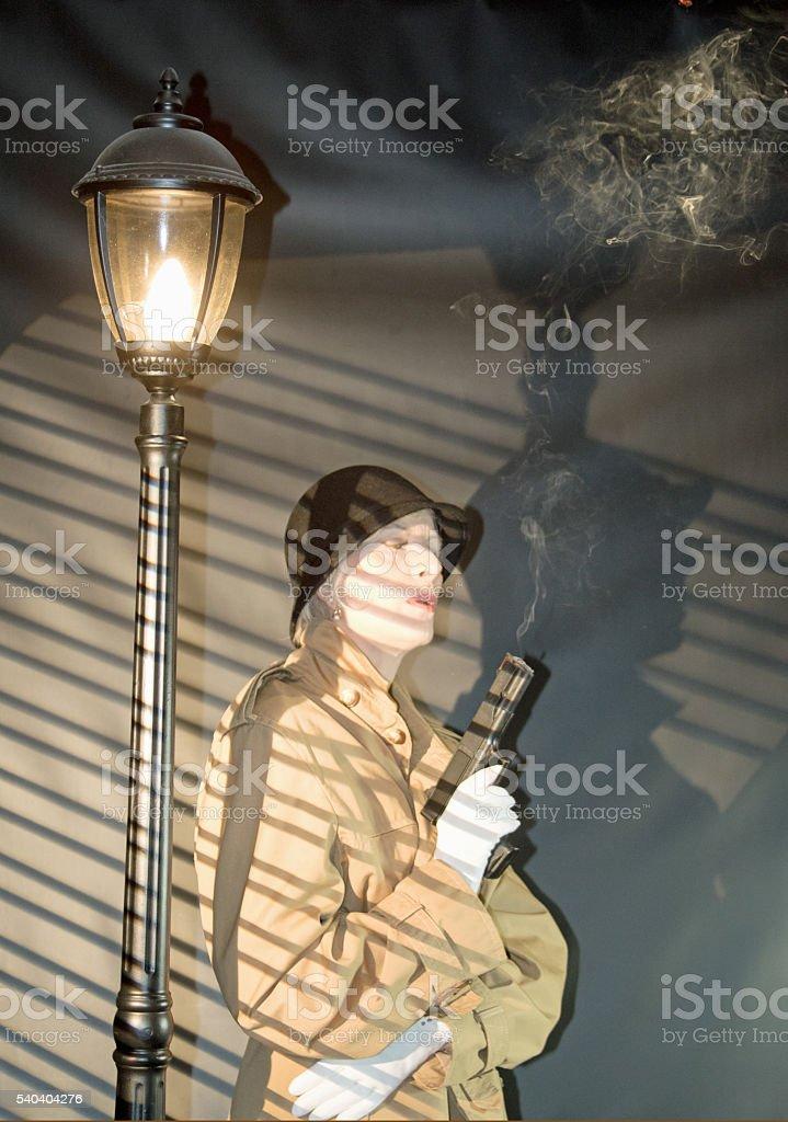 Senior Female Blowing Smoke From Pistol stock photo