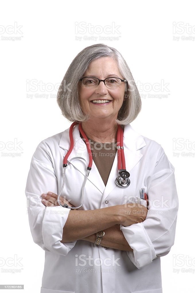 senior female doctor with arms crossed royalty-free stock photo