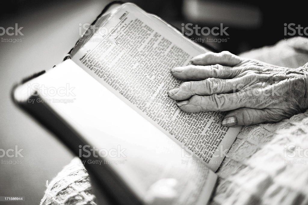 senior female elderly woman reading bible royalty-free stock photo